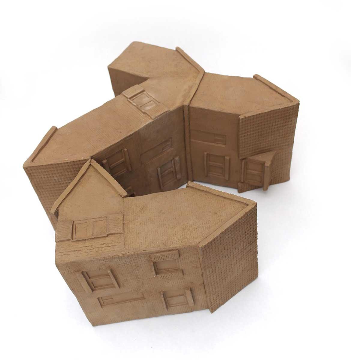 Assemblage de maisons. Terres cuites nues.